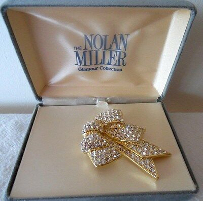 The Nolan Miller Glamour Collection Clear Crystal Bow Pin Mib
