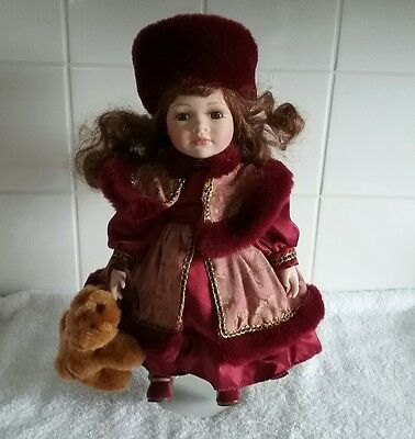Porcelain Doll Red Outfit On Stand