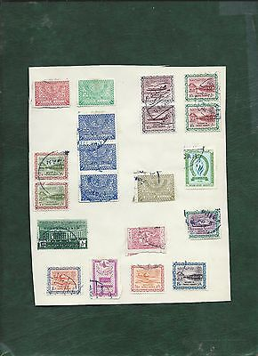 Saudi Arabia 37 old used stamps on album pages