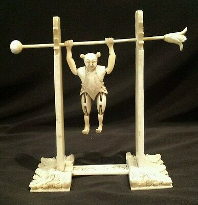 A rare 19thC Canton carved Chinese articulated Acrobat on carved floral stand.