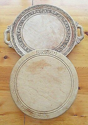 Two Vintage Round  Bread Boards One With Double Handles And Carvings