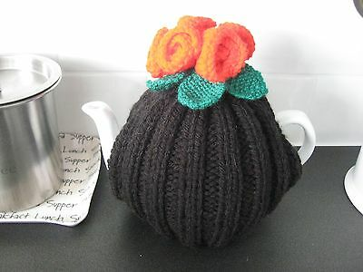 Hand knitted tea cosy, black, red roses, medium size