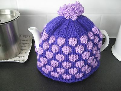 Hand knitted tea cosy, purple and lilac , medium size