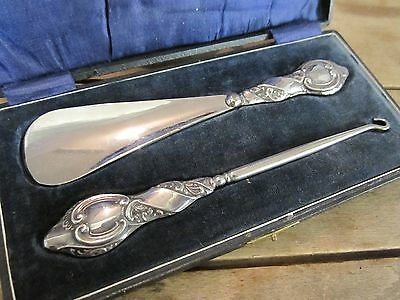Hallmarked Chester 1920 silver repousse shoe horn and hook set cased