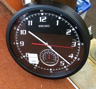 "Seiko  New 13.5"" Wall Clock With A Thermometer Dial Above ""6""  Qxa696Klh"