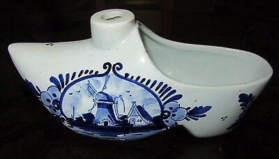 Delfis Holland Done In  Blue And White Clog Lettering Underneath