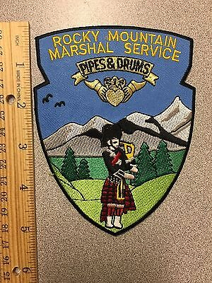 Rocky Mountain  Wyoming Marshal Service Pipes & Drums   Shoulder Patch