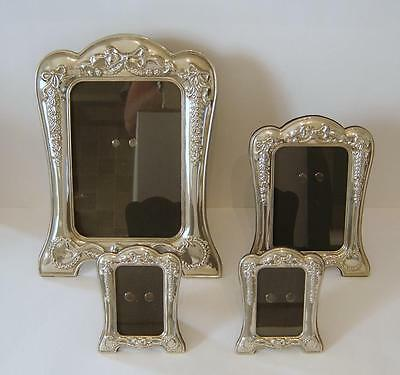 A Set Of Four Ornate Flower & Bow Embossed Silverplated Photograph Frames