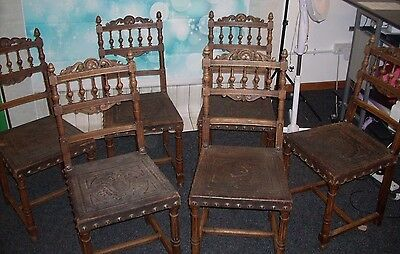 Set of Six  French Renaissance Style oak and embossed leather dining chairs