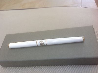 Vintage Cadillac deluxe pen white and gold from Williamson Cadillac