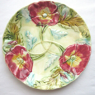 French Majolica plate, in slip, signed ONNAING, 3 red poppies