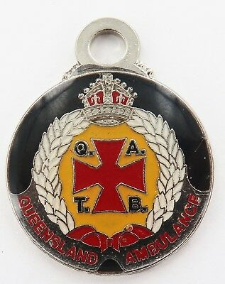 c1970's / 1980's QATB QLD AMBULANCE METAL FOB. 28MM DIAMETER, MAKER A J PARKES.
