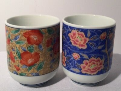 """2 Asian Porcelain Tea Cups Floral Design 3 1/2""""tall  3"""" Wide. Marked"""
