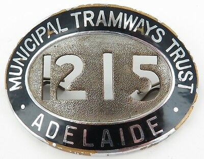 .VINTAGE ADELAIDE MUNICIPAL TRAMWAYS TRUST LARGE BADGE. No. 1215. 6.3CMS WIDE