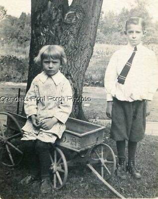 RPPC TWO LITTLE BOYS w TOY WAGON OUTDOORS ANTIQUE REAL PHOTO POSTCARD c 1910