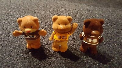 Lot of Three flocked Bears M & M tan, M&M Brown arms behind back , Snickers tan.