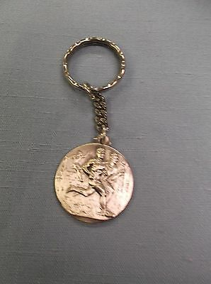 "track medal silver male cross country key chain 1 1/4"" diameter"