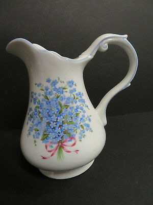 A Special Place 2004 ~ Blue Floral White Pitcher ~ 9 1/4 inches tall (L8)