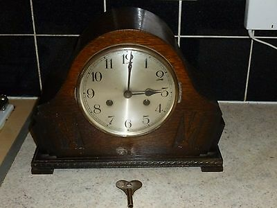 Antique Striking Mantel Clock in Oak Case