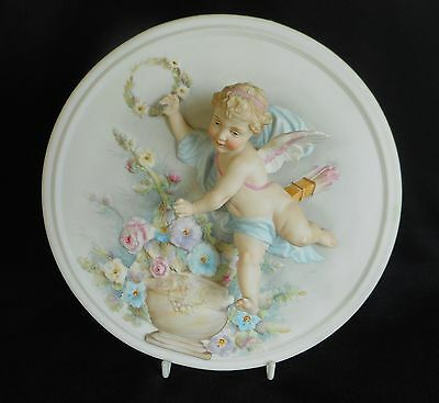 Superb Bisque Porcelain Plaque Depicting Cupid With Arrows And Garland Of Flower