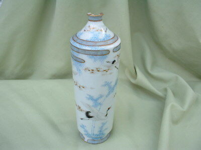 A vintage Japanese Porcelain Vase painted with the Red Crown Crane. Damaged.