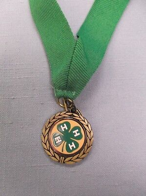 4H star trophy award gold medal green neck drape