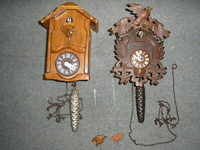 Two Traditional 1 Weight Driven Carved Wood Case Cuckoo Clocks