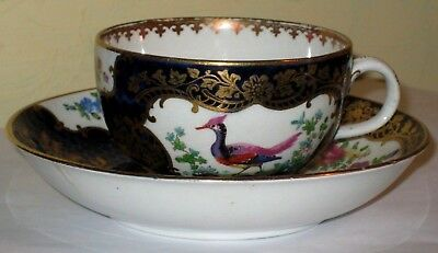 19thc gilded cup and saucer with exotic bird decoration