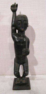 VINTAGE AFRICAN CARVED MAN FIGURE BLACK PIGMENT Raised Arm WITH BENT KNEES