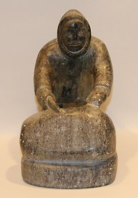 Inuit Carved Soapstone Sculpture of a Figure of a Man Cleaning Fish