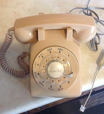Working dial desk phone with plug in phone jack and filter