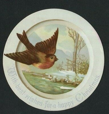 Victorian Christmas card,Circular,Robin in flight ,Snowy Country Scene.1884.