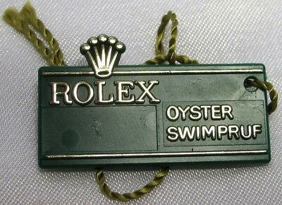 """Rolex Label, """"rolex Oyster Swimpruf"""" Green Plastic With String, Genuine & Nice"""