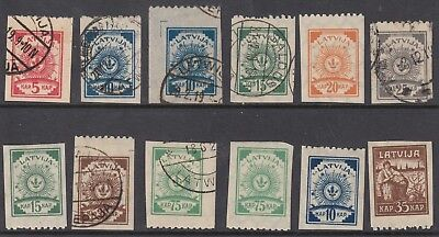 LATVIA group of mostly Arms stamps with interpane perforation top or bottom