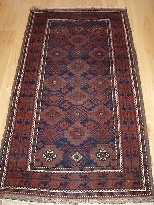 Antique Baluch Rug With Repeat Design, Heavy Corrosion, Circa 1900.
