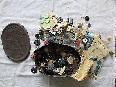 Vintage tin box full of vintage buttons - excellent for crafts
