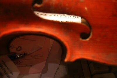 4 old violins  , slightly small sized , one has name Alberto Vaccari inside 1957