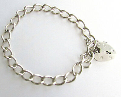 Vintage sterling silver charm bracelet with heart lock clasp Birmingham 1976