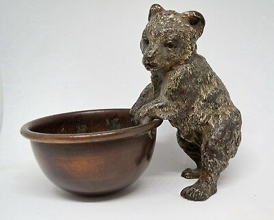 Antique cold painted bronze bear cub holding bowl