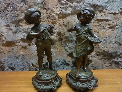 A pair of Antique Spelter Bronzed Boy & Girl figurines signed, unsure of name
