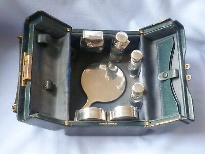 Very rare Asprey vanity case with solid silver boxes, mirror, scent bottles
