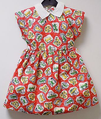 VINTAGE 1970s UNWORN GIRLS RED & WHITE 'TOY' PRINT PATTERNED DRESS AGE 2-3 YEARS
