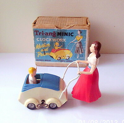 Tri-Ang Minic Clockwork Mother And Pram From 1950's