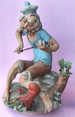 A VINTAGE GINO PEZZATO for CAPODIMONTE PORCELAIN SCULPTURE - FISHERMAN WITH BOOT
