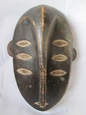African patinated wooden carved Kwele mask. Gabon / Cameroon / Congo