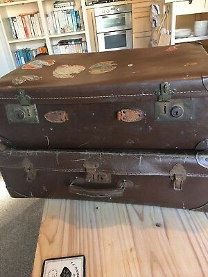 2 Vintage brown leather suitcases