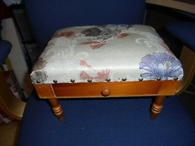 Padded footstool with storage drawer