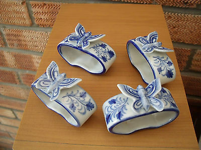 Blue & White Napkin Rings with Butterflies & Flower decoration probably Chinese.