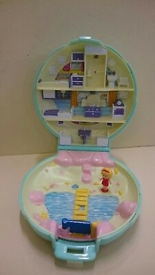 Polly Pocket beach house compact. Pink inner colouring. With one figure. 1989.