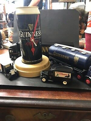 Job lot of Guinness collectibles clock and trucks